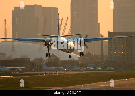 Fokker 50 KLM UK Cityhopper London City Airport Millenium Dome in the background - Stock Photo