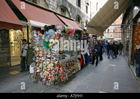 Typical Venetian carnival masks on sale at this street souvenir stand near Rialto Bridge, Venice Italy Europe EU - Stock Photo