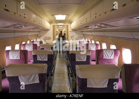Duxford Imperial War Museum BOAC Cunard Super VC10 passenger jet airliner cabin interior being viewed by visitors - Stock Photo