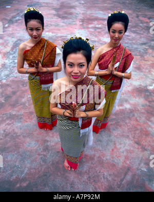 Portrait of three women in traditional Thai costume, Chiang Mai, Thailand - Stock Photo