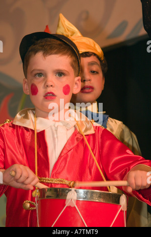Schoolboys Dressed In Costume For School Play Performing On Stage - Stock Photo