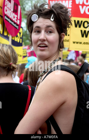 A tall brunette registers surprise at the huge crowd on the mall during the Pro Choice March on Washington DC in - Stock Photo