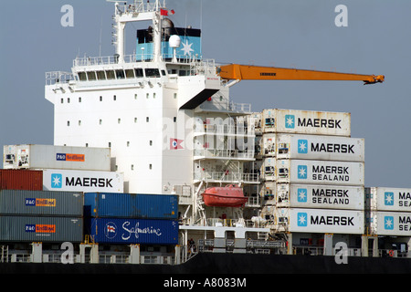 stacked container boxes for importing and exporting on the container ship carrier MAERSK Nottingham on Southampton - Stock Photo