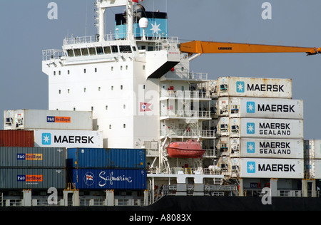 stacked container boxes for importing and exporting on the container carrier MAERSK Nottingham on Southampton Water - Stock Photo