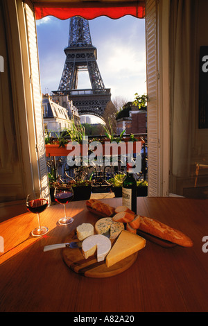 Wine cheese and bread in apartment near Eiffel Tower - Stock Photo
