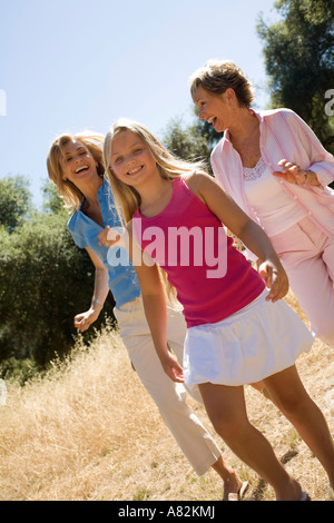 A mother daughter and granddaughter at a park - Stock Photo