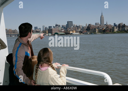Man with two little girls sightseeing - Stock Photo