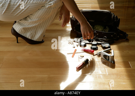 Woman picking makeup articles, side view - Stock Photo