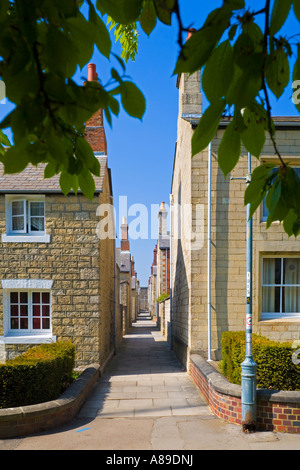 Alleyway in between Great Western Railway village Swindon workers houses built with stone from the Box Tunnel near - Stock Photo