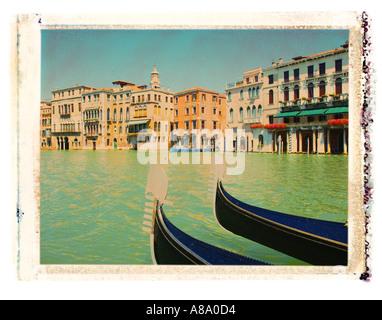 Gondolas along the Grand Canal in Venice Italy - Stock Photo
