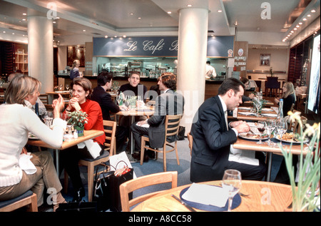 French 'Businesspersons Having Lunch' in 'Trendy Cafe' 'Bistro Restaurant' in Lanvin Store, Basement, Paris, France - Stock Photo