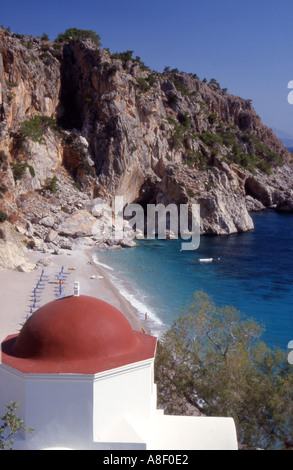 Greece Karpathos The secluded beach at Kyra Panaghia and its Greek Orthodox church - Stock Photo