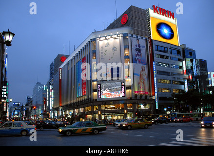 Bright Lights on Ginza Shopping District in Tokyo Japan - Stock Photo