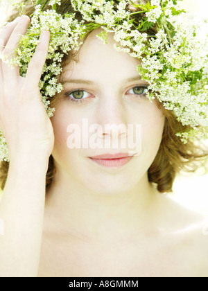 Teenage girl with green eyes and cow parsley wild chervil in her hair pale skin elph nimph summer spring - Stock Photo