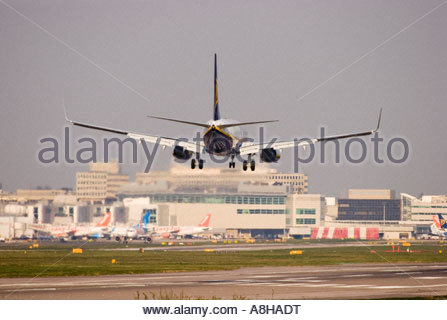 Boeing 737 civil airliner landing at London Gatwick. - Stock Photo