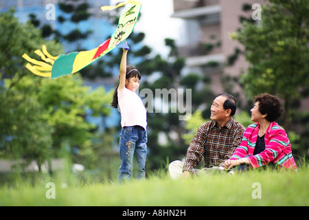 View of a couple sitting in a garden  - Stock Photo