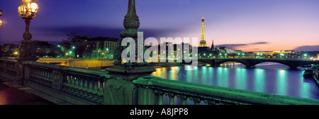 River Seine Eiffel Tower at dusk from Pont Alexandre III Paris France - Stock Photo