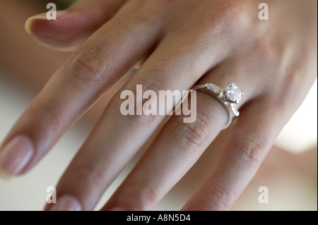 Woman s hand wearing an engagement ring - Stock Photo