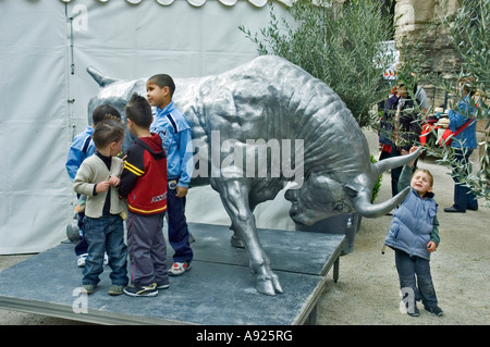 Arles, France, Feria Bullfighting Sculpture Festival Street Scene, mixed Group French Children, Playing with Public - Stock Photo