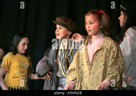 Children girls playing on a stage performance performing communicating team working rehearsal feelings theater creative - Stock Photo