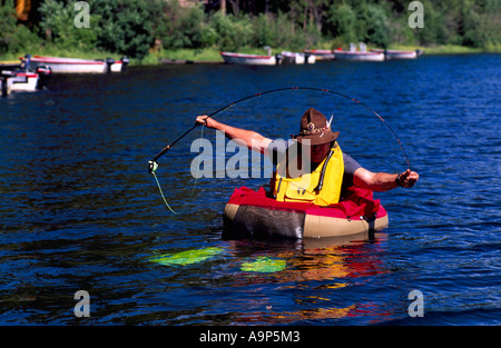Fly fisherman in float tube trout fishing the hiwassee for Belly boat fishing
