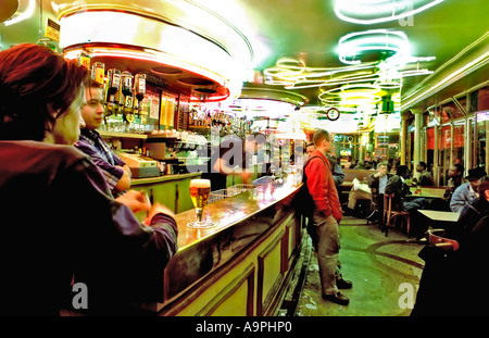 Paris Cafe, France Adults Hanging Out Paris Café Bar in the Belleville Area 'Aux Folie's Bar' (1950s Interior Design) - Stock Photo