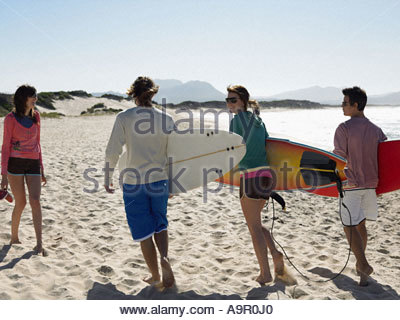 Friends going surfing - Stock Photo