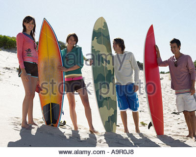 Friends with surfboards - Stock Photo