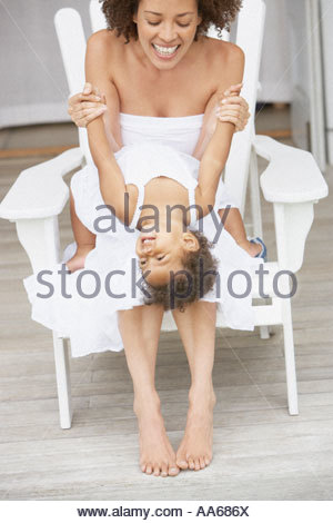 Mother sitting with daughter in summer - Stock Photo