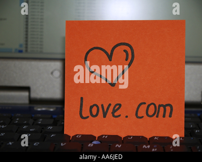 memo note on notebook drawing of heart love com - Stock Photo