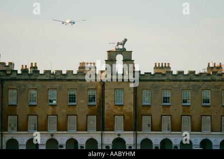 An Aircraft Descending Into Heathrow Airport Flies Over Syon House West London UK