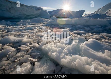 Greenland Ilulissat Icebergs from Ilulissat Kangerlua Glacier Jakobshavn Icefjord floating on calm seas in Disko - Stock Photo