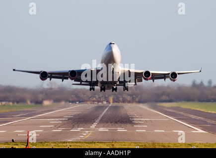 Head on of a Being 747 400 Jumbo jet civil airliner taking off from London Gatwick airport - Stock Photo
