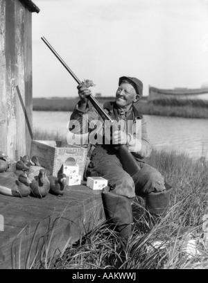 1920s 1930s Senior Man Hunting Clothes Sitting Spit Rail