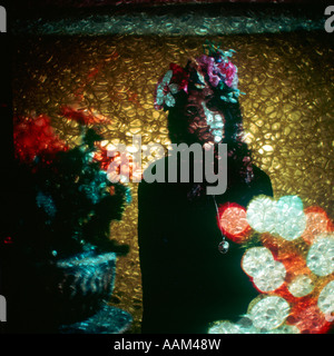 1960s 1970s PSYCHEDELIC EFFECT YOUNG HIPPIE WOMAN WITH FLOWERS ON HEAD - Stock Photo