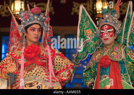Two male stars in full costume at Chinese Opera Chengdu China in Sichuan Province - Stock Photo