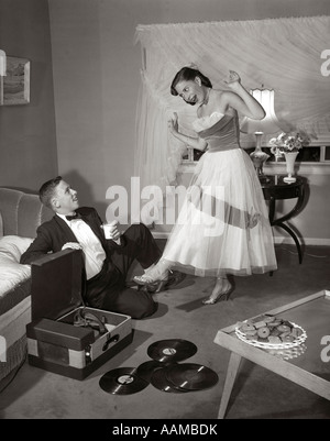 1950s Pair Of Women Sitting On Living Room Sofa Talking