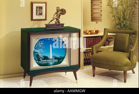 CONSOLE TV AND CHAIR IN LIVING ROOM - Stock Photo