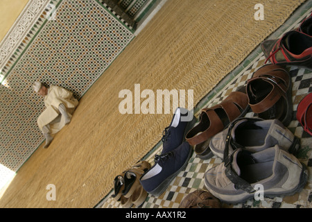 Shoes by the entrance of the Moulay Ismail mosque, Meknes, Morocco - Stock Photo