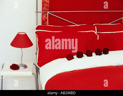 Interior a red and white bedroom heart and rose detail - Stock Photo