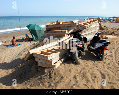 Holiday hell building materials litter the beach as for Beach house construction materials