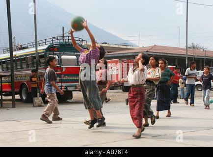 Indigenous children playing basketball in Santiago de Atitlan, Lake Atitlan, Guatemala - Stock Photo