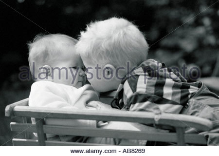 Two babies kissing - Stock Photo