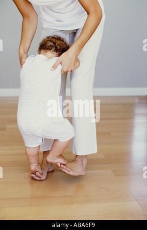 Toddler's first steps - Stock Photo