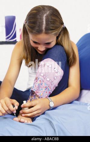 Teenage girl applying makeup - Stock Photo