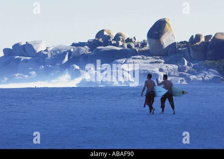 Surfers on beach - Stock Photo