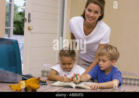 Children drawing with mother - Stock Photo
