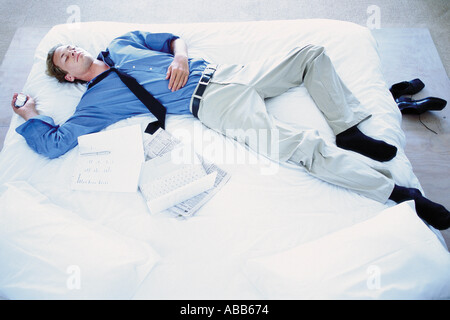 Man lying on bed - Stock Photo