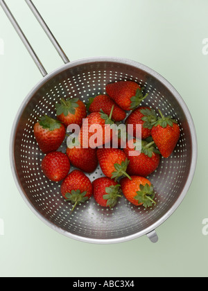 Strawberries in colander - Stock Photo