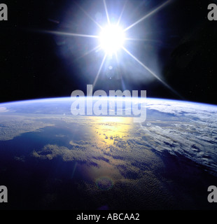 Earth from space showing sunrise over the Globe - Stock Photo